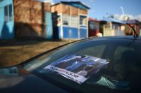 """A sign on a car in Kabul last week showed a Taliban member beating a woman and read, """"Afghanistan will not go back.""""CreditCreditWakil Kohsar/Agence France-Presse — Getty Images"""