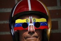 An anti-government protester wears Venezuelan flag sunglasses during a demonstration to demand the resignation of President Nicolás Maduro in Caracas, the country's capital. (Fernando Llano/AP)