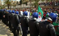 Algerian anti-riot police stand guard during a March 5 demonstration in the northern coastal city of Oran, against the ailing president's bid for a fifth term. (-/AFP/Getty Images)
