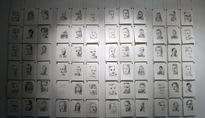 Portraits by '3 Robots Named Paul' - an art installation by Patrick Tresset which uses robots to sketch human models. Photo: Getty Images.