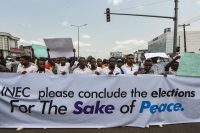 Protesters hold banners during a demonstration against the suspension of governorship elections in Port Harcourt, Nigeria, on March 11. (Pius Utomi Ekpei/AFP/Getty Images)