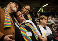 In St. Louis on Feb. 26, 2019, Ed Rowe, left, Rebecca Wilson, Robin Hager and Jill Zundel react to the defeat of a proposal that would allow LGBT clergy and same-sex marriage within the United Methodist Church. (Sid Hastings/Associated Press)