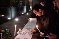 People write condolence messages to the victims of a mass shooting in Christchurch, New Zealand, during a candlelight vigil outside the New Zealand Embassy in Brussels on Friday. (Laurie Dieffembacq/AFP/Getty Images)