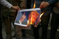 Demonstrators burn a picture of President Trump during a protest last May in response to his decision to pull out of the international nuclear deal and renew sanctions. Credit Vahid Salemi / Associated Press