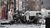 Police And Forensics Attend Scene After Car Bomb At Londonderry Courthouse