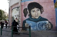 A mural on the wall of the headquarters of the United Nations Relief and Works Agency (UNRWA) in Gaza City last October. Credit Said Khatib / Agence France-Presse — Getty Images