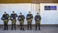 Ukrainian special forces soldiers stand guard in front of the Central Electoral Commission in Kyiv on 1 April. Photo: Getty Images.