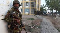 A member of the Kenyan Defence Forces stands guard at the Garissa University campus after an attack by Somalia's Al-Qaeda-linked Shebab gunmen in Garissa on 2 April 2015. CARL DE SOUZA / AFP
