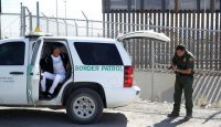 A US Border Patrol agent detains migrants at the border in El Paso, Texas. Photo: Getty Images.