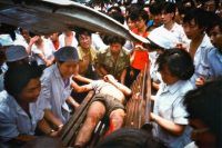 An injured man is taken to a hospital during an uprising in Chengdu, China, on June 4, 1989. (Kim Nygaard)