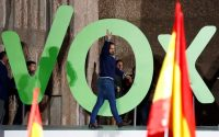 Santiago Abascal, leader of Spain's Vox party, waves to supporters at a rally in Madrid on April 26. (Juan Medina/Reuters)