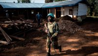 A soldier from MONUSCO patrols outside an Ebola Treatment Centre in Butembo, the epicentre of Democratic Republic of the Congo's latest Ebola outbreak, after it was attacked 9 March. Photo: Getty Images.