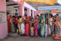 Indian women stand in line to cast their votes at a polling station in Neemrana, in the state of Rajasthan, on May 6, 2019. (Manish Swarup/AP)