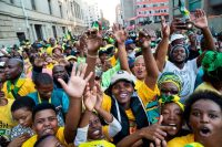 African National Congress (ANC) supporters cheer while they wait for the speech of President-elect Cyril Ramaphosa of South Africa outside the ANC's headquarters in Johannesburg, on Sunday. (Wikus De Wet/AFP/Getty Images)