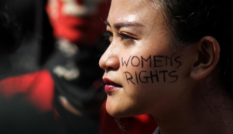 Campaigners call for gender equality and women's rights on International Women's Day in front of the Presidential Palace in Jakarta, Indonesia on 8 March 2019. Photo: Getty Images.