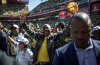 Cyril Ramaphosa waving at supporters in Ellis Park Stadium in Johannesburg on Sunday.CreditCreditMarco Longari/Agence France-Presse — Getty Images