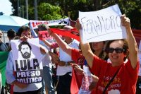 Demonstrators in front of the Justice Ministry in Brasilia on Monday call for the release of former president Luiz Inácio Lula da Silva and the resignation of Justice Minister Sérgio Moro. (Evaristo Sa/AFP/Getty Images)
