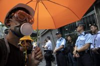 Protesters surrounded police headquarters in Hong Kong on June 21.CreditPaula Bronstein/Getty Images