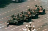A Chinese man stands alone to block a line of tanks heading east on Beijing's Changan Boulevard in Tiananmen Square on June 5, 1989. (Jeff Widener/AP)