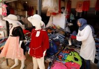 A vendor displays clothing in the marketplace on May 24, 2019, in the Tunisian town of Ben Guerdane, near the border with Libya. (Zoubeir Souissi/Reuters)