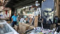 A Muqtada al-Sadr mobile phone cover for sale in a Baghdad market. Photo: Getty Images.