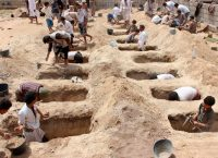 Yemenis digging graves last year for children who were killed by a Saudi-led coalition airstrike on a market in the province of Saada.CreditCreditAgence France-Presse — Getty Images