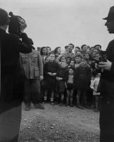 Journalists documenting children being held at the Vichy government's Rivesaltes Camp during World War II. Credit Daniel Bénédite and Varian Fry