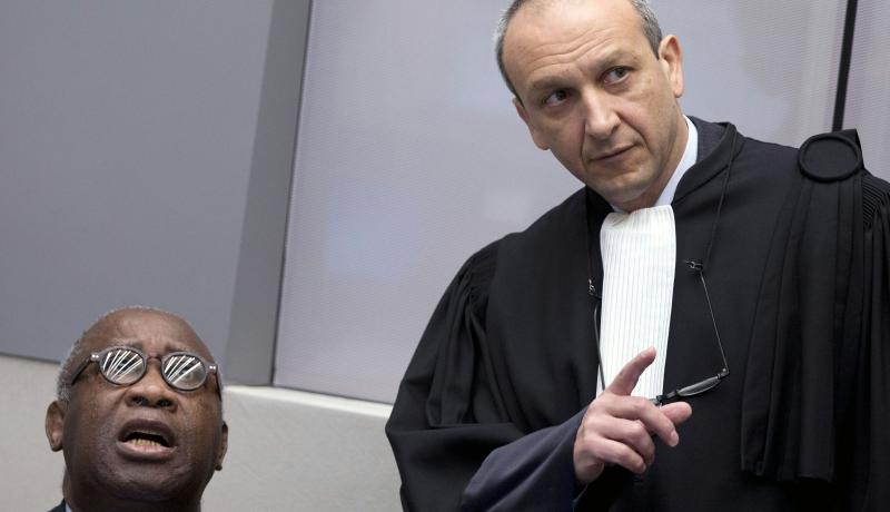 Laurent Gbagbo looks on next to his lawyer Emmanuel Altit before the start of his trial at the ICC on 28 January 2016. Photo by Getty Images.