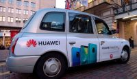 A London taxi advertises Huawei products. Photo: Getty Images.