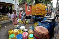 Residents collect drinking water from a municipal tanker in Kolkata, India, on July 8. India's National Institution for Transforming India has warned that many states in the country will gradually run out of water because of climate change and population growth. (Piyal Adhikary/EPA-EFE)