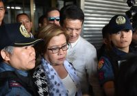 Leila de Lima, center, after her arrest in 2017. Credit Ted Aljibe/Agence France-Presse — Getty Images