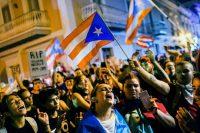 Manifestantes en San Juan reclamaron en una serie de protestas masivas la renuncia de Ricardo Rosselló. Credit Dennis M. Rivera Pichardo/Associated Press