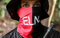 An ELN guerrilla commander in the jungle, in the Choco department of Colombia, on May 25. (Raul Arboleda/AFP/Getty Images)