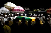 Ethiopian deacons stand by the coffin of the army's chief of staff, Gen. Seare Mekonnen, who was shot by his bodyguard on June 22. (Baz Ratner/Reuters)