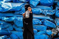 A woman and an infant at Al Hol, a camp for displaced people in northeastern Syria in July.CreditCreditDelil Souleiman/Agence France-Presse — Getty Images
