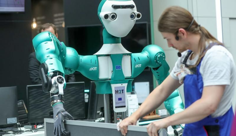 The Armar-6 humanoid robot takes part in a warehouse assistant demonstration at the CeBIT 2018 tech fair in Hanover, Germany, on 11 June 2018. Photo: Getty Images.