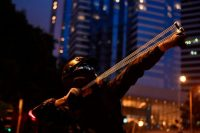 A protester uses a slingshot in Hong Kong on Saturday.CreditCreditLillian Suwanrumpha/Agence France-Presse — Getty Images