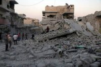 People search for victims under the rubble of buildings that were hit by airstrikes in the northern Syrian town of Maaret al-Numan in Idlib province, in a photo released last month by the opposition Syrian Civil Defense rescue group, also known as White Helmets. (AP)