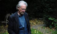 Peter Handke poses outside his home near Paris after winning the Nobel prize for literature. Photograph: Julien de Rosa/EPA