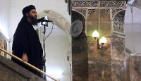 An image grab from a video released in 2014 shows Abu Bakr al-Baghdadi preaching at a mosque in Mosul. Photo by Al-Furqan Media/Anadolu Agency/Getty Images