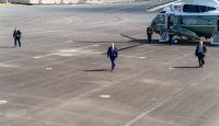 Donald Trump walks from Marine One to Air Force One at Ocala International Airport on 3 October. Photo: Getty Images.