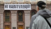 A banner reading 'No capitulation!' is unfurled above the entrance to the city hall in Kyiv as part of protests against implementation of the so-called Steinmeier Formula. Photo: Getty Images.