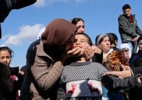 Dilbar Ali Ravu, 10, is kissed by his aunt, Dalal Ravu, as Yazidi children are reunited with their families in Iraq after five years of captivity with the Islamic State group, March 2, 2019. AP Photo/Philip Issa, File