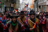 Supporters of Evo Morales wearing traditional ponchos and holding Wiphala flags take part in a protest on Nov. 14 in La Paz, Bolivia. (Getty Images)