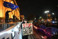 Protesters demanding the government's resignation and early parliamentary polls rally in front of Parliament in Tbilisi, Georgia, on Tuesday. (Vano Shlamov/AFP via Getty Images)