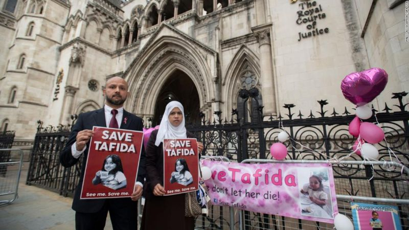 Shelina Begum and husband Mohammed Raqeeb stand at the Royal Courts of Justice in London in September.