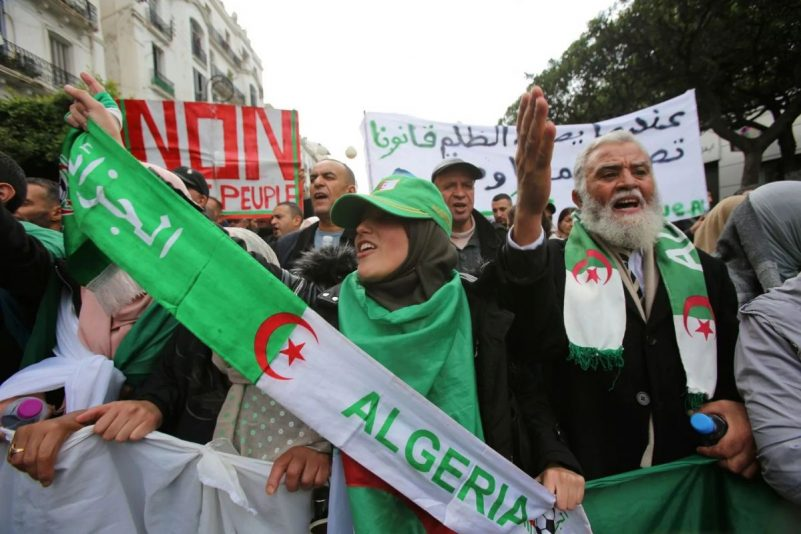 Demonstrators protest the country's ruling elite and the December presidential election in Algiers on Tuesday. (Ramzi Boudina/Reuters)