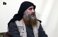 Islamic State leader Abu Bakr al-Baghdadi being interviewed by his group's Al-Furqan media outlet for a video released on April 29. (AP)