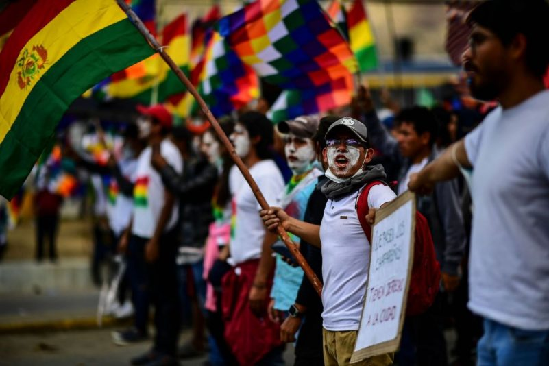 Supporters of former Bolivian president Evo Morales shout slogans during a demonstration in Cochabamba on Monday. (Ronaldo Schemidt/AFP via Getty Images)