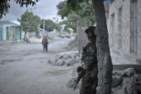 A soldier on the African Union Mission in Somalia standing guard on a street during a security operation in Mogadishu, Somalia. EPA/Tobin Jones